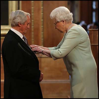 Bob Woodward receives his OBE from Her Majesty The Queen